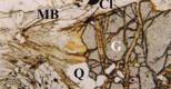 Retrogradação de granada (Gt), envolvendo recristalização de clorite (Cl), mica